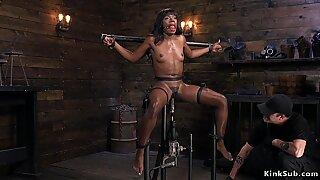 Hairy ebony slave rides fucking machine