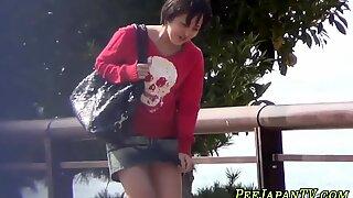 Japanese teenager pissing