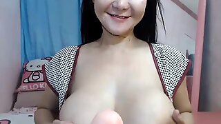 sweetkitty0419 hanging out with her (huge natural) tits out